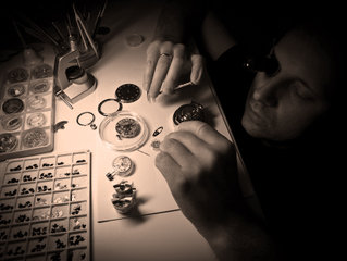 Maxim Nazarov is assembling watch in his workshop