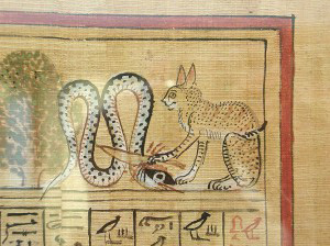 cat with its paw bends the head of the serpent, and the other paw puts a knife