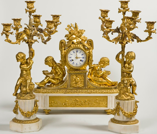 Mantel clock with figures on a marble pedestal. France first half of the XIX century