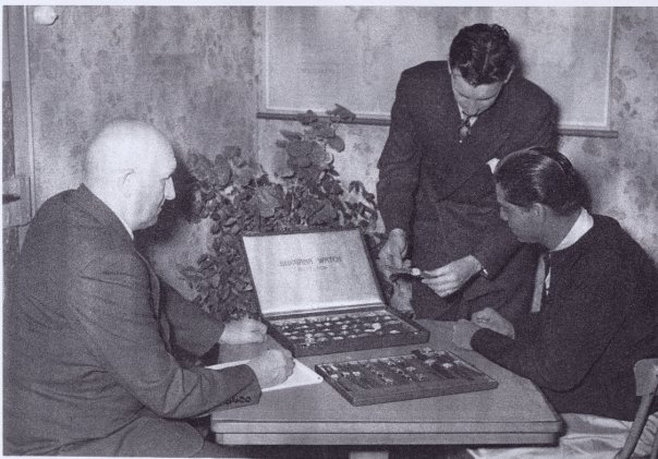 Photo was taken 1953 and shows Rolf von Burgs grand father Werner von Burg together with his father Edgar von Burg presenting the new collection of Burgana watches to one of their customers