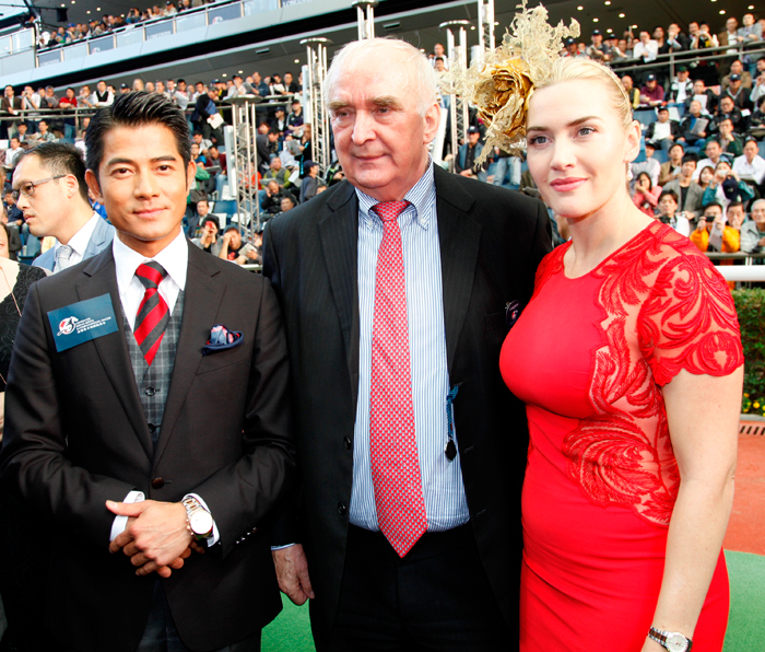 Longines President, Mr. Walter von Kennel, Longines Ambassador Kate Winslet and Mr. Aaron Kuok Fu Shing on the parade at the Sha Tin Racecourse closing.