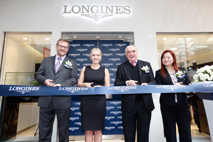 Kate Winslet opens a new Longines boutique on Lockhart Road. The ribbon with Kate Winslet was cut by Mr. Walter von Kennel, President of Longines, Mr. Kevin Rollenhagen, managing director of Swatch Group in Hong Kong, Mr. Juan-Carlos Capelli, vice president and head of the international department of marketing Longines and Karen O Young, a vice president of Longines in Hong Kong.