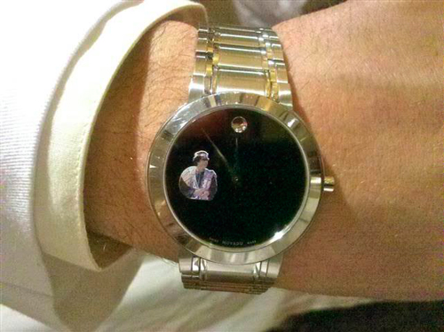 Movado watch on the dial of which is depicted the face of the Libyan leader Muammar Gaddafi