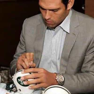 a football star Mark Sanchez at the Breitling boutique opening