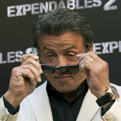 "Sylvester Stallone appeared at premiere of the movie ""The Expendables-2"" with Carl F. Bucherer Patravi TravelTec GMT watch"