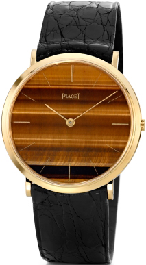 Watch in yellow gold, the dial of tiger's eye, mechanism Piaget 9P, 1969